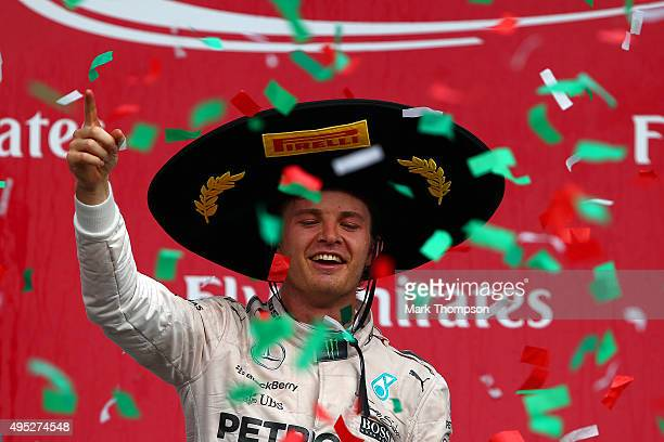 Nico Rosberg of Germany and Mercedes GP celebrates on the podium after winning the Formula One Grand Prix of Mexico at Autodromo Hermanos Rodriguez...