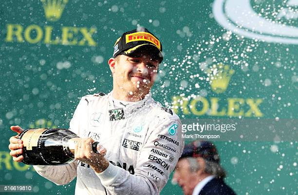 Nico Rosberg of Germany and Mercedes GP celebrates on the podium after winning the Australian Formula One Grand Prix at Albert Park on March 20 2016...