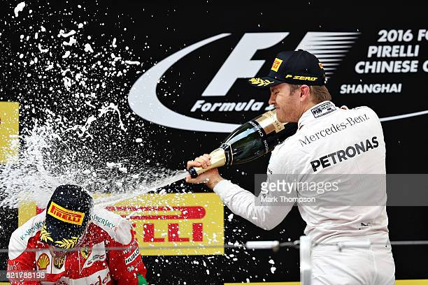 Nico Rosberg of Germany and Mercedes GP celebrates on the podium with Sebastian Vettel of Germany and Ferrari during the Formula One Grand Prix of...