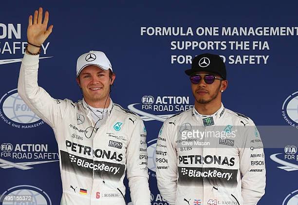 Nico Rosberg of Germany and Mercedes GP celebrates pole position as team mate and second place driver Lewis Hamilton of Great Britain and Mercedes GP...