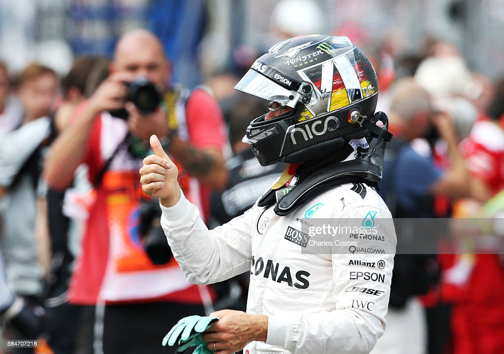 Nico Rosberg of Germany and Mercedes GP celebrates qualifying in pole position in parc ferme during qualifying for the Formula One Grand Prix of...