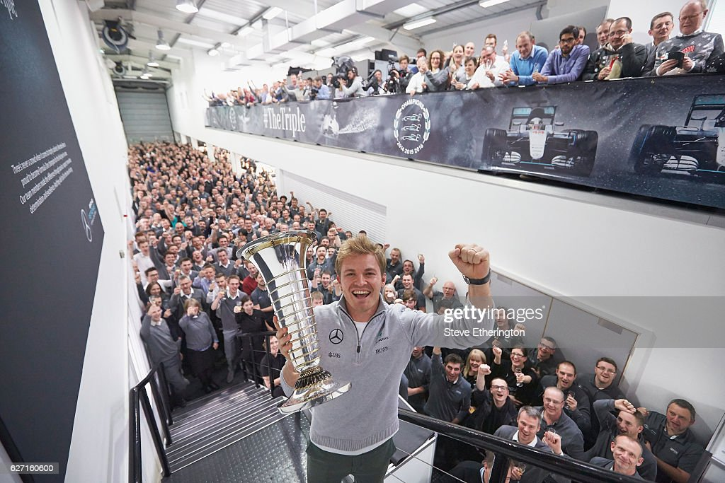 Nico Rosberg of Germany and Mercedes GP celebrates winning the F1 World Drivers Championship with Mercedes GP staff on December 1, 2016 in Brackley, England.