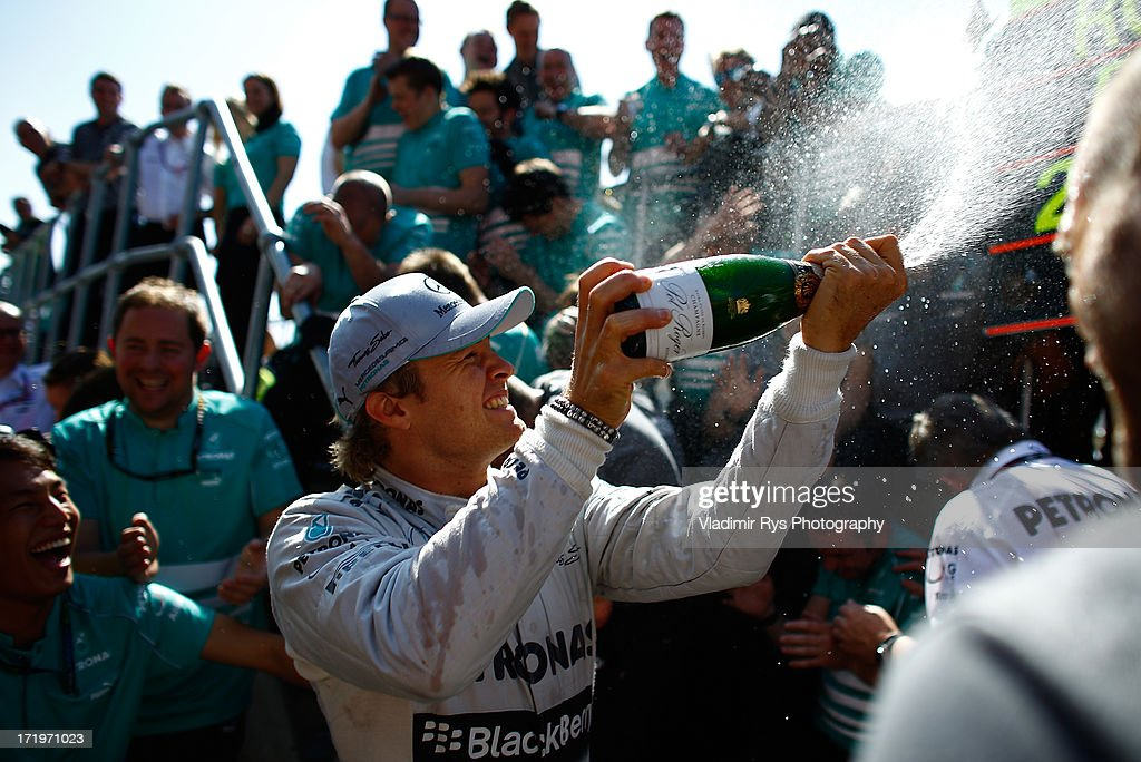 Nico Rosberg of Germany and Mercedes GP celebrates with his team after winning the British Formula One Grand Prix at Silverstone Circuit on June 30, 2013 in Northampton, England.
