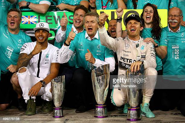 Nico Rosberg of Germany and Mercedes GP celebrates with his team including Lewis Hamilton of Great Britain and Mercedes GP outside the garage after...