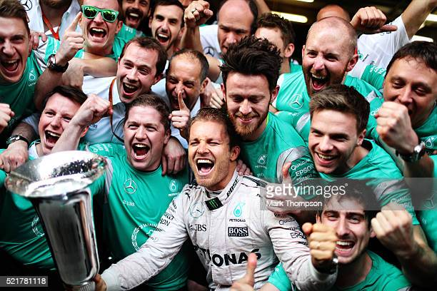 Nico Rosberg of Germany and Mercedes GP celebrates with his team after winning the Formula One Grand Prix of China at Shanghai International Circuit...