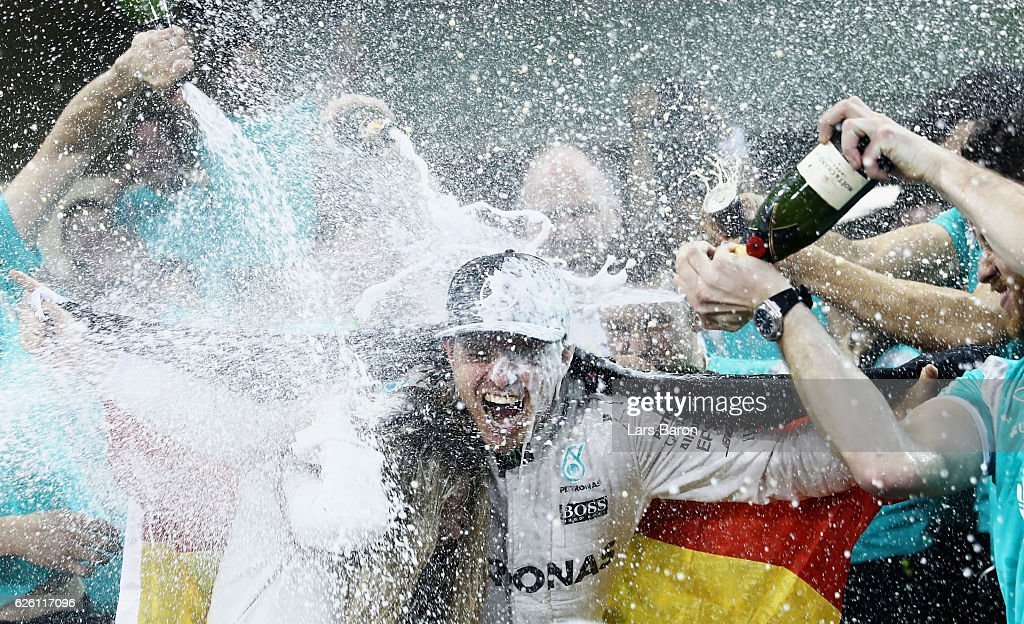 Nico Rosberg of Germany and Mercedes GP celebrates with his team after finishing second and securing the F1 World Drivers Championship during the Abu Dhabi Formula One Grand Prix at Yas Marina Circuit on November 27, 2016 in Abu Dhabi, United Arab Emirates.