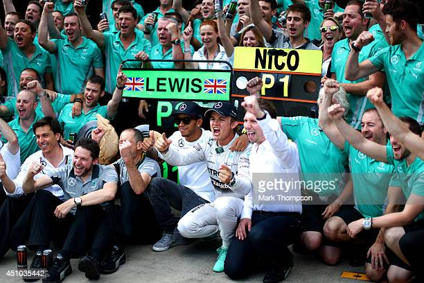 Nico Rosberg of Germany and Mercedes GP celebrates with Lewis Hamilton of Great Britain and Mercedes GP after victory in the Austrian Formula One...