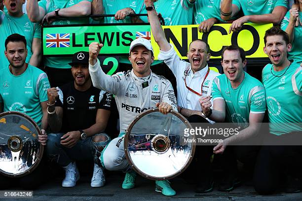 Nico Rosberg of Germany and Mercedes GP celebrates with Lewis Hamilton of Great Britain and Mercedes GP and his team during the Australian Formula...