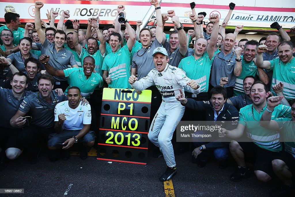 <a gi-track='captionPersonalityLinkClicked' href=/galleries/search?phrase=Nico+Rosberg&family=editorial&specificpeople=800808 ng-click='$event.stopPropagation()'>Nico Rosberg</a> of Germany and Mercedes GP celebrates with team mate Lewis Hamilton and the rest of his team after winning the Monaco Formula One Grand Prix at the Circuit de Monaco on May 26, 2013 in Monte-Carlo, Monaco.