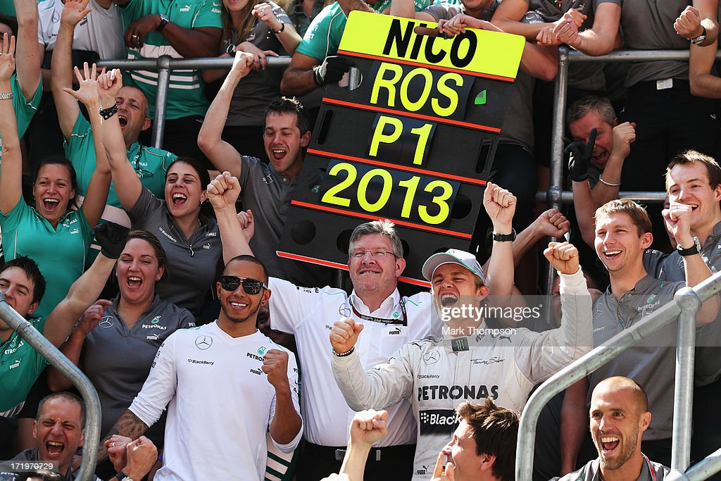 Nico Rosberg of Germany and Mercedes GP celebrates with team mate Lewis Hamilton of Great Britain and Mercedes GP Mercedes GP Team Principal Ross...