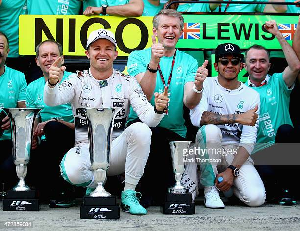Nico Rosberg of Germany and Mercedes GP celebrates with the team including Lewis Hamilton of Great Britain and Mercedes GP after winning the Spanish...