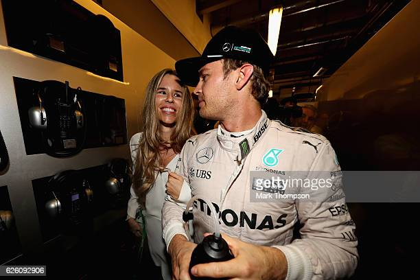 Nico Rosberg of Germany and Mercedes GP celebrates with wife Vivian Sibold after finishing second and winning the World Drivers Championship during...