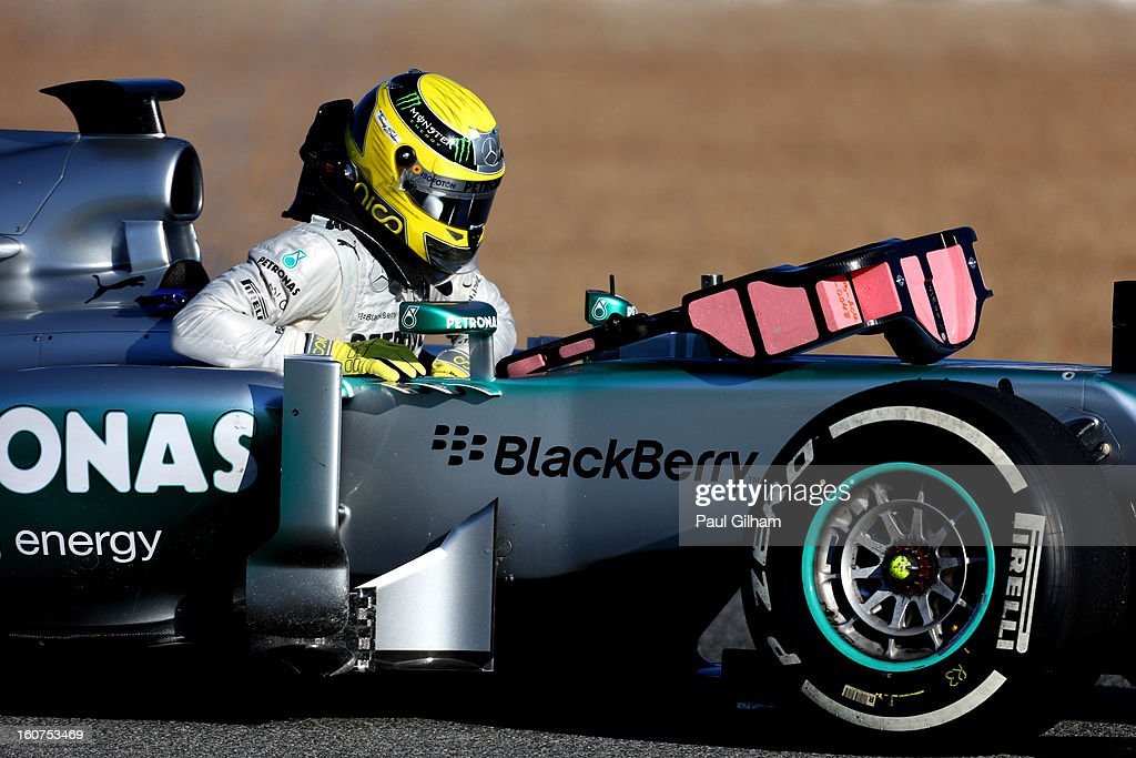 Nico Rosberg of Germany and Mercedes GP climbs out of his W04 after flames erupted from the rear of the car during Formula One winter testing at Circuito de Jerez on February 5, 2013 in Jerez de la Frontera, Spain.