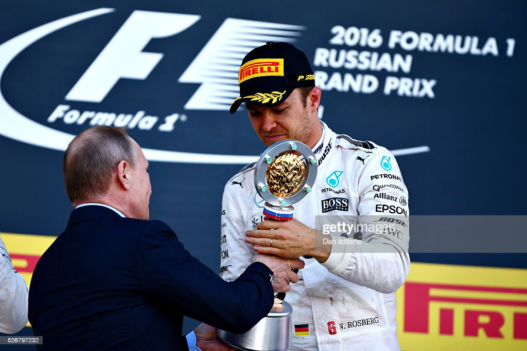 <a gi-track='captionPersonalityLinkClicked' href=/galleries/search?phrase=Nico+Rosberg&family=editorial&specificpeople=800808 ng-click='$event.stopPropagation()'>Nico Rosberg</a> of Germany and Mercedes GP collects his winners trophy from Russian President <a gi-track='captionPersonalityLinkClicked' href=/galleries/search?phrase=Vladimir+Putin&family=editorial&specificpeople=154896 ng-click='$event.stopPropagation()'>Vladimir Putin</a> on the podium during the Formula One Grand Prix of Russia at Sochi Autodrom on May 1, 2016 in Sochi, Russia.