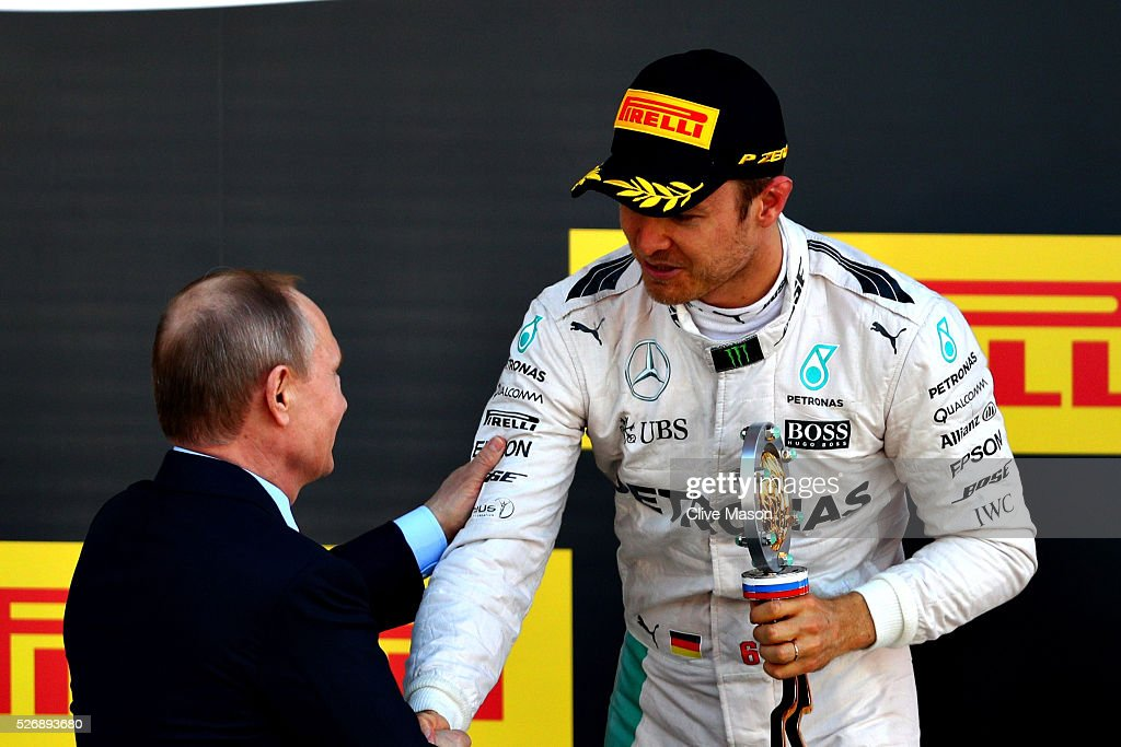 <a gi-track='captionPersonalityLinkClicked' href=/galleries/search?phrase=Nico+Rosberg&family=editorial&specificpeople=800808 ng-click='$event.stopPropagation()'>Nico Rosberg</a> of Germany and Mercedes GP collects his winners trophy from Russian President <a gi-track='captionPersonalityLinkClicked' href=/galleries/search?phrase=Vladimir+Putin&family=editorial&specificpeople=154896 ng-click='$event.stopPropagation()'>Vladimir Putin</a> during the Formula One Grand Prix of Russia at Sochi Autodrom on May 1, 2016 in Sochi, Russia.
