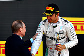 Nico Rosberg of Germany and Mercedes GP collects his winners trophy from Russian President Vladimir Putin during the Formula One Grand Prix of Russia...