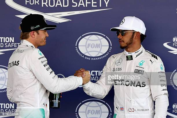 Nico Rosberg of Germany and Mercedes GP congratulates Lewis Hamilton of Great Britain and Mercedes GP after Lewis qualified on pole during qualifying...