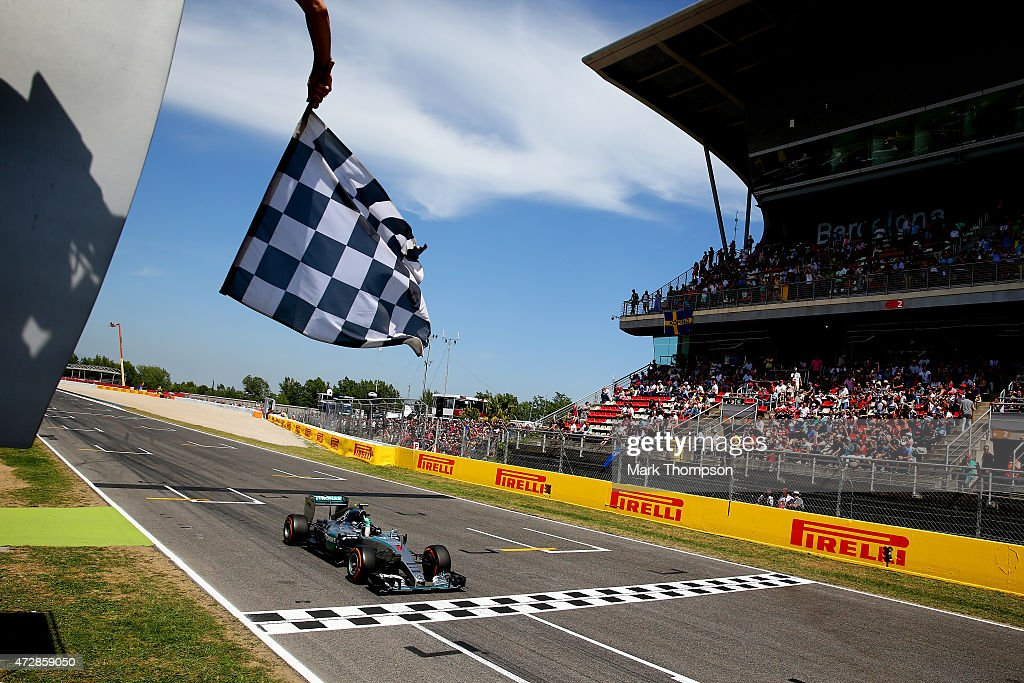 Nico Rosberg of Germany and Mercedes GP crosses the finish line to win the Spanish Formula One Grand Prix at Circuit de Catalunya on May 10 2015 in...