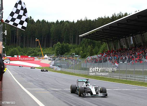 Nico Rosberg of Germany and Mercedes GP crosses the finish line to win the Formula One Grand Prix of Austria at Red Bull Ring on June 21 2015 in...