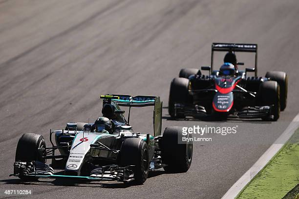 Nico Rosberg of Germany and Mercedes GP drives ahead of Fernando Alonso of Spain and McLaren Honda during the Formula One Grand Prix of Italy at...