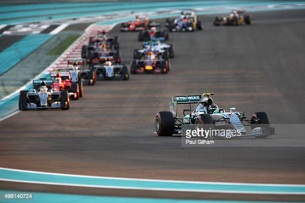 Nico Rosberg of Germany and Mercedes GP drives ahead of Lewis Hamilton of Great Britain and Mercedes GP during the Abu Dhabi Formula One Grand Prix...