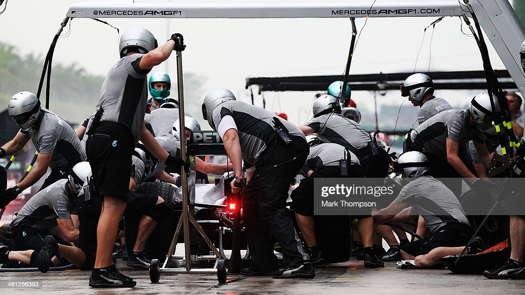 Nico Rosberg of Germany and Mercedes GP drives in for a pitstop during qualifying for the Malaysia Formula One Grand Prix at the Sepang Circuit on March 29, 2014 in Kuala Lumpur, Malaysia.