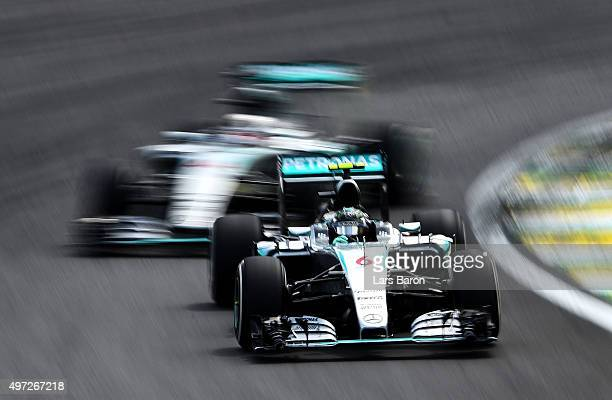 Nico Rosberg of Germany and Mercedes GP drives infront of Lewis Hamilton of Great Britain and Mercedes GP during the Formula One Grand Prix of Brazil...