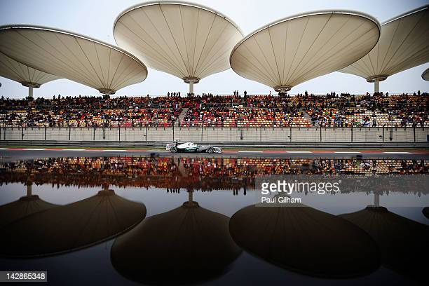 Nico Rosberg of Germany and Mercedes GP drives on his way to finishing first during qualifying for the Chinese Formula One Grand Prix at the Shanghai...