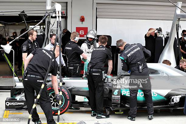 Nico Rosberg of Germany and Mercedes GP gets out of his car in the Pitlane during qualifying for the Formula One Grand Prix of Russia at Sochi...
