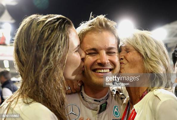 Nico Rosberg of Germany and Mercedes GP is congratulated on securing the F1 World Drivers Championship by his wife Vivian Sibold and mother Sina...