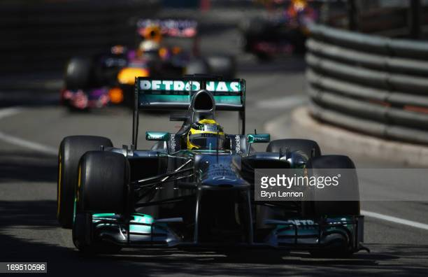 Nico Rosberg of Germany and Mercedes GP leads from second placed Sebastian Vettel of Germany and Infiniti Red Bull Racing and third placed Mark...