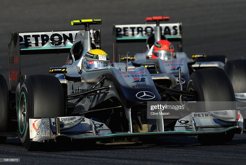 Nico Rosberg of Germany and Mercedes GP leads from team mate Michael Schumacher of Germany and Mercedes GP during the Japanese Formula One Grand Prix at Suzuka Circuit on October 10, 2010 in Suzuka, Japan.