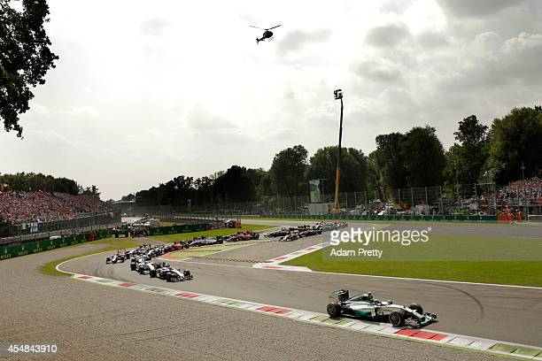 Nico Rosberg of Germany and Mercedes GP leads going out the first corner during the F1 Grand Prix of Italy at Autodromo di Monza on September 7 2014...