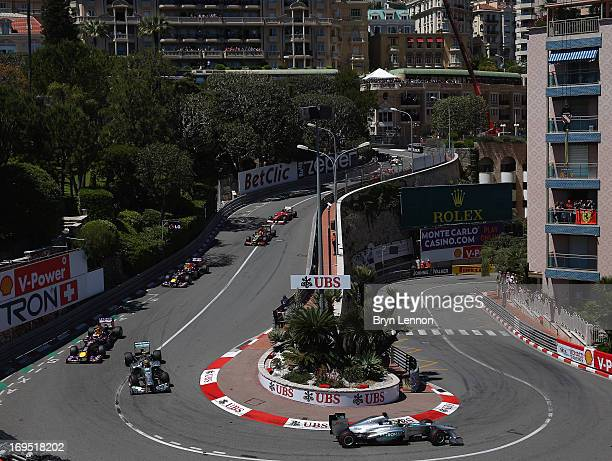 Nico Rosberg of Germany and Mercedes GP leads his team mate Lewis Hamilton of Great Britain and Mercedes GP and the rest of the field round the...