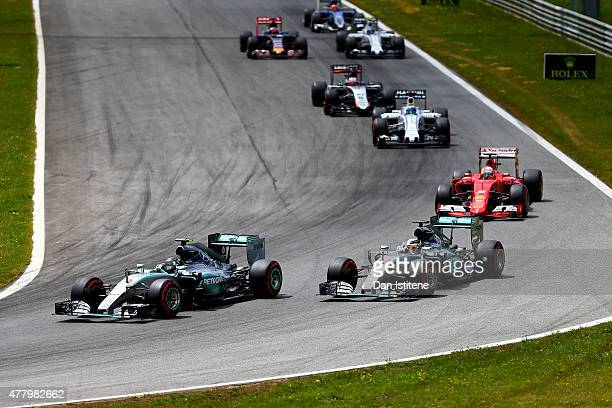 Nico Rosberg of Germany and Mercedes GP leads Lewis Hamilton of Great Britain and Mercedes GP and Sebastian Vettel of Germany and Ferrari during the...