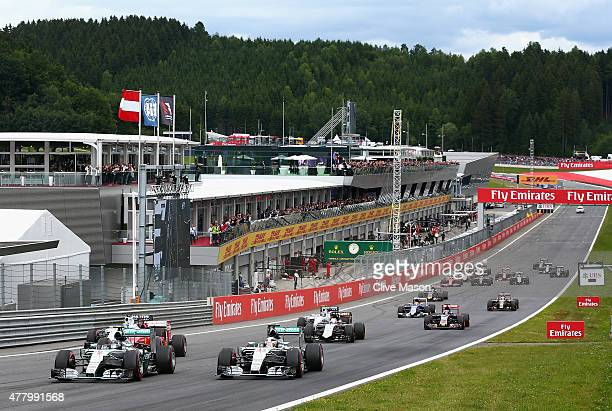 Nico Rosberg of Germany and Mercedes GP leads Lewis Hamilton of Great Britain and Mercedes GP and Sebastian Vettel of Germany and Ferrari as they...