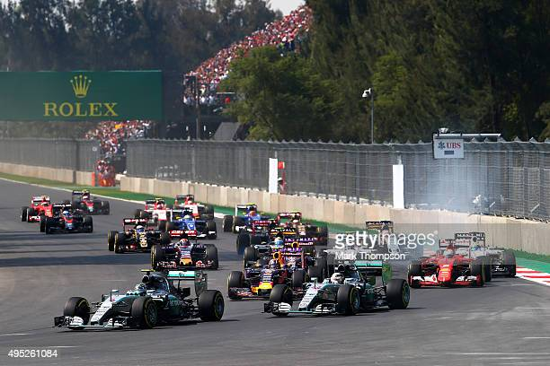 Nico Rosberg of Germany and Mercedes GP leads Lewis Hamilton of Great Britain and Mercedes GP Daniil Kvyat of Russia and Infiniti Red Bull Racing...