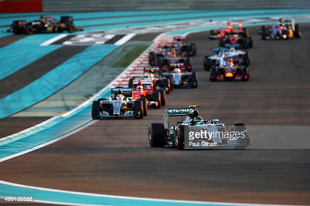 Nico Rosberg of Germany and Mercedes GP leads Lewis Hamilton of Great Britain and Mercedes GP and Kimi Raikkonen of Finland and Ferrari as Fernando...