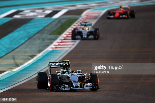 Nico Rosberg of Germany and Mercedes GP leads Lewis Hamilton of Great Britain and Mercedes GP and Kimi Raikkonen of Finland and Ferrari during the...