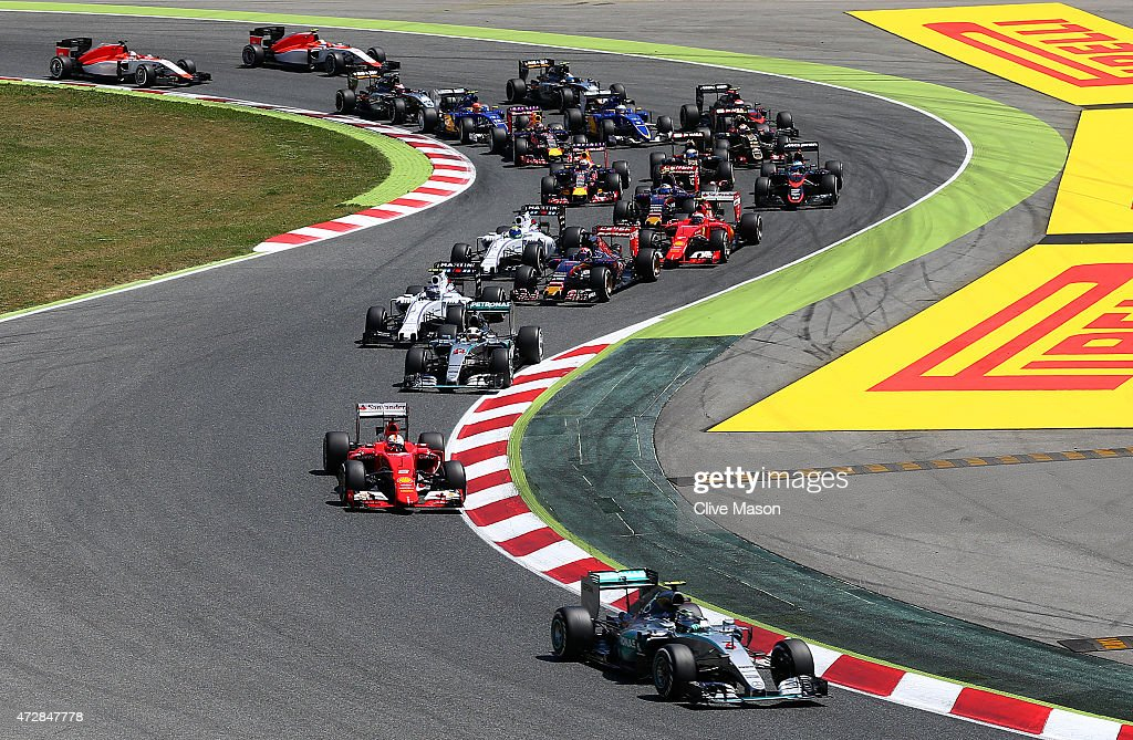 Nico Rosberg of Germany and Mercedes GP leads Sebastian Vettel of Germany and Ferrari and Lewis Hamilton of Great Britain and Mercedes GP into the...