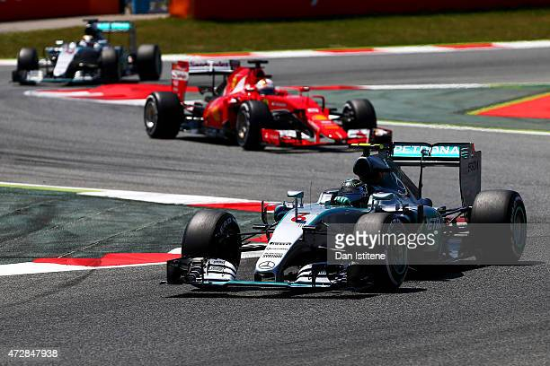 Nico Rosberg of Germany and Mercedes GP leads Sebastian Vettel of Germany and Ferrari and Lewis Hamilton of Great Britain and Mercedes GP during the...