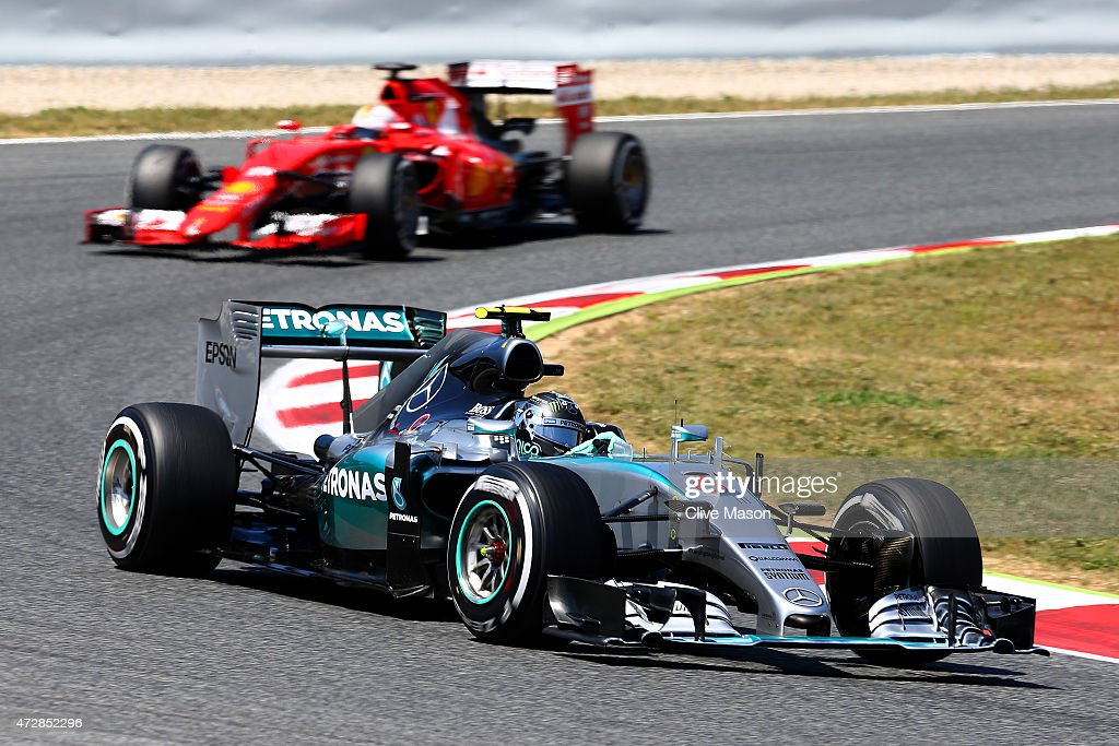 Nico Rosberg of Germany and Mercedes GP leads Sebastian Vettel of Germany and Ferrari during the Spanish Formula One Grand Prix at Circuit de...