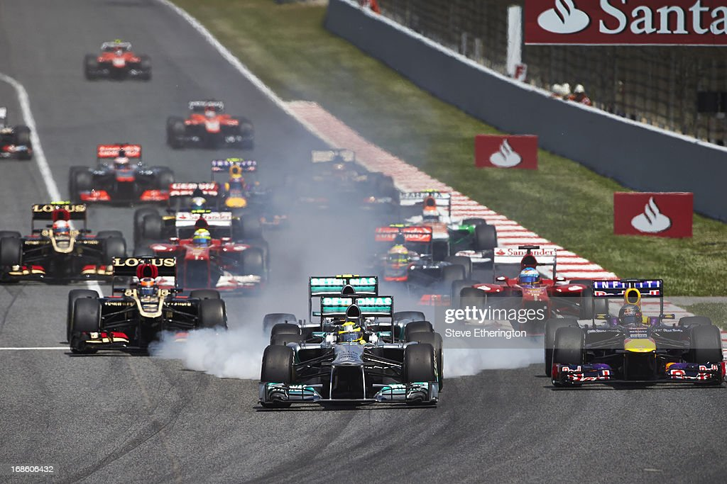 Nico Rosberg of Germany and Mercedes GP leads the field into the first corner at the start of the Spanish Formula One Grand Prix at the Circuit de Catalunya on May 12, 2013 in Montmelo, Spain.