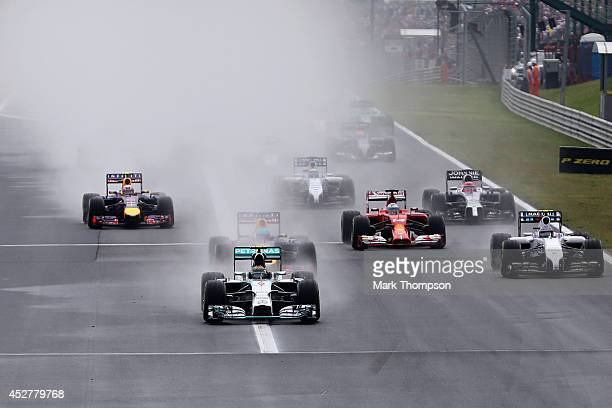 Nico Rosberg of Germany and Mercedes GP leads the field into the first corner during the Hungarian Formula One Grand Prix at Hungaroring on July 27...