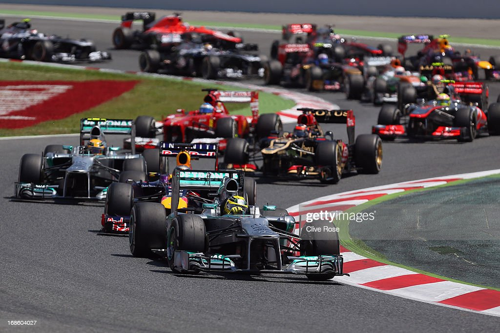 Nico Rosberg of Germany and Mercedes GP leads the field through the first corner at the start of the Spanish Formula One Grand Prix at the Circuit de Catalunya on May 12, 2013 in Montmelo, Spain.