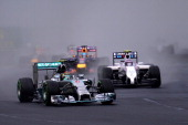 Nico Rosberg of Germany and Mercedes GP leads Valtteri Bottas of Finland and Williams and Sebastian Vettel of Germany and Infiniti Red Bull Racing...