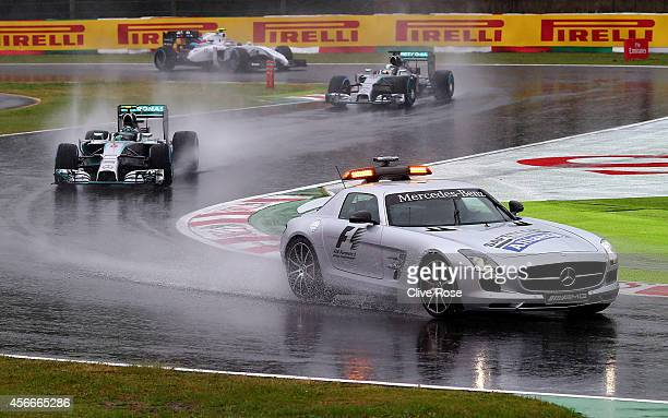 Nico Rosberg of Germany and Mercedes GP Lewis Hamilton of Great Britain and Mercedes GP and Valtteri Bottas of Finland and Williams follow the safety...
