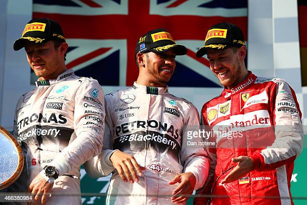 Nico Rosberg of Germany and Mercedes GP Lewis Hamilton of Great Britain and Mercedes GP and Sebastian Vettel of Germany and Ferrari celebrate on the...