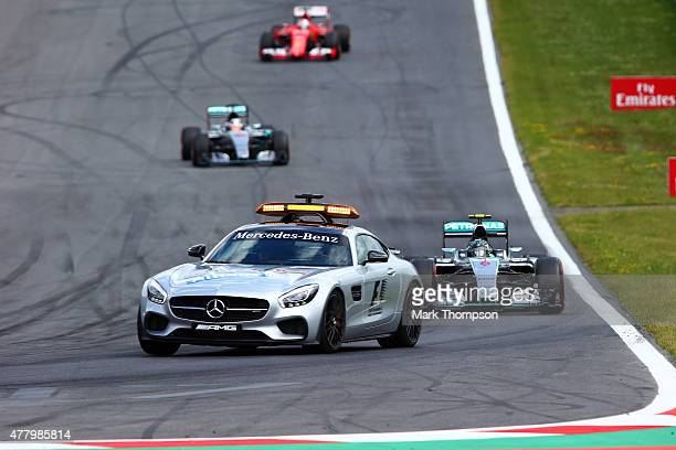 Nico Rosberg of Germany and Mercedes GP Lewis Hamilton of Great Britain and Mercedes GP and Sebastian Vettel of Germany and Ferrari follow the safety...