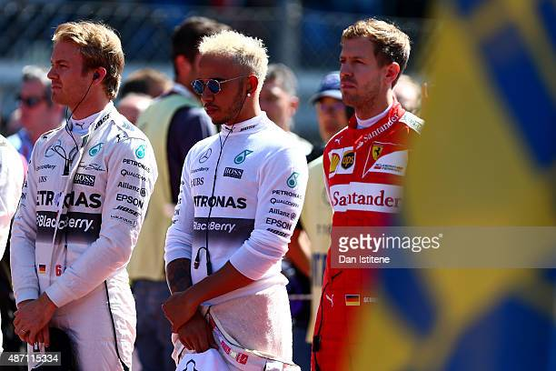Nico Rosberg of Germany and Mercedes GP Lewis Hamilton of Great Britain and Mercedes GP and Sebastian Vettel of Germany and Ferrari stand for the...